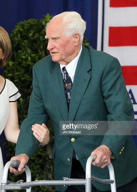 Hall of Famer Bobby Doerr is introduced at Clark Sports Center during the Baseball Hall of Fame induction ceremony on July 24 2011 in Cooperstown New...