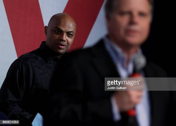 Hall of Famer Charles Barkley looks on as democratic Senatorial candidate Doug Jones speaks during a get out the vote campaign rally on December 11...