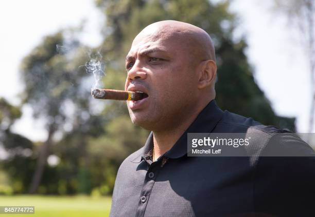 Hall of Famer Charles Barkley looks on while smoking a cigar during the Julius Erving Golf Classic at The ACE Club on September 11 2017 in Lafayette...