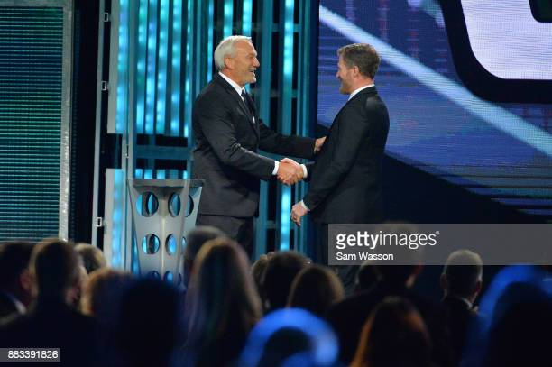 Hall of Famer Dale Jarrett shakes hands with NASCAR driver Dale Earnhardt Jr during the Monster Energy NASCAR Cup Series awards at Wynn Las Vegas on...