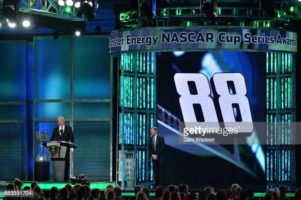 Hall of Famer Dale Jarrett speaks as NASCAR driver Dale Earnhardt Jr looks on during the Monster Energy NASCAR Cup Series awards at Wynn Las Vegas on...