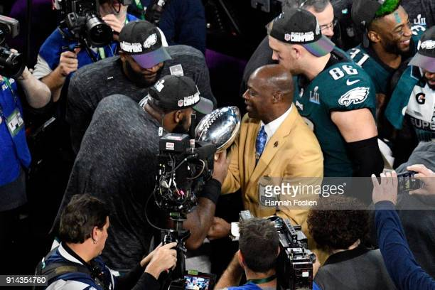 Hall of Famer Darrell Green carries the Lombardi trophy to the stage after the Philadelphia Eagles defeated the New England Patriots 4133 in Super...