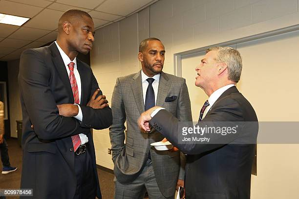 Hall of Famer Dikembe Mutombo and former Atlanta Hawks player Steve Smith talk to Atlanta Hawks owner Tony Ressler after the game on November 24 2015...