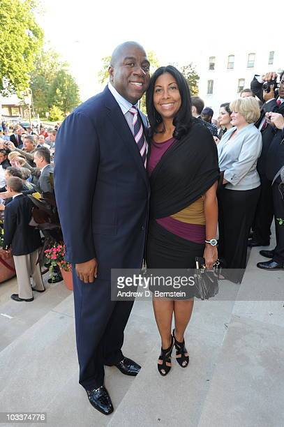 Hall of Famer Earvin Magic Johnson and wife Cookie enters the Red Carpet during the Basketball Hall of Fame Class of 2010 Induction Ceremony at the...