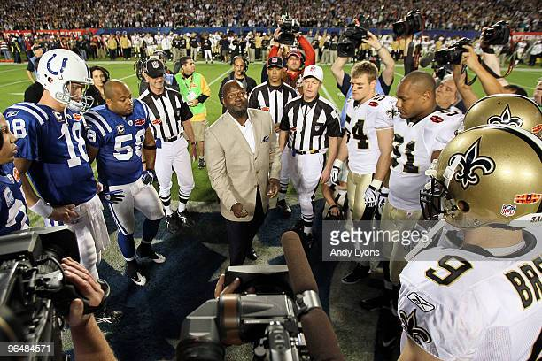 Hall of Famer Emmitt Smith flips the coin prior to the start of Super Bowl XLIV between the Indianapolis Colts and the New Orleans Saints on February...