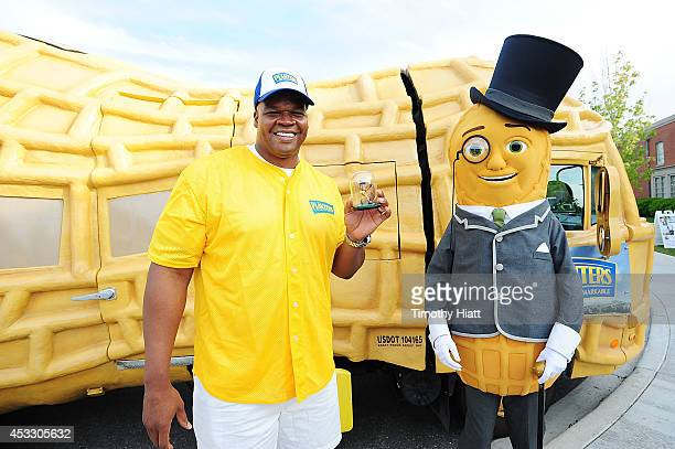 Hall of Famer Frank Thomas holds a custom Planters Peanut figurine during the Planters Power Hitter Event at the Skokie Playfields on August 6 2014...