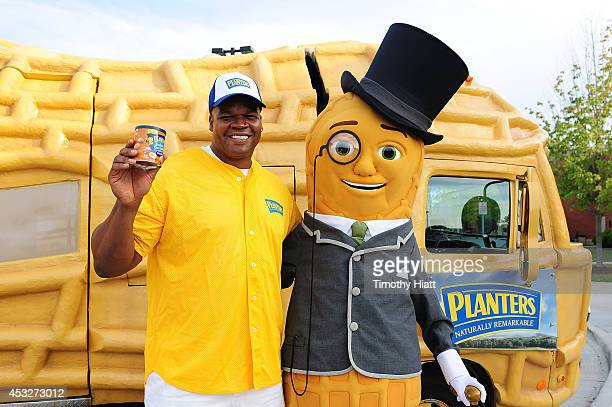 Hall of Famer Frank Thomas poses with Mr Peanut in front of the Planters NUTmobile during the Planters Power Hitter Event at the Skokie Playfields on...