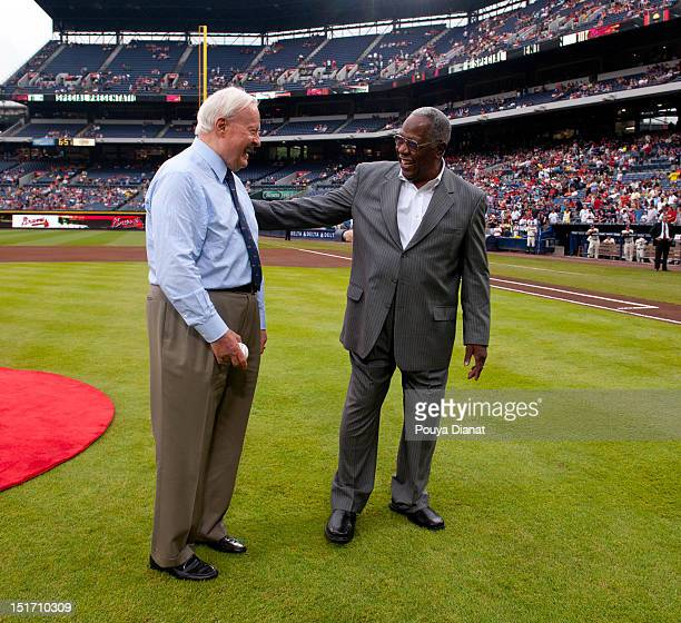 Hall of Famer Hank Aaron encourages Chairman Emeritus of the Atlanta Braves Bill Bartholomay before he throws out the ceremonial first pitch before...