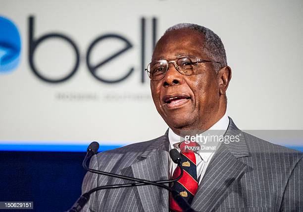 Hall of Famer Hank Aaron honors Bill Bartholomay for 50 Years in Baseball at the 2012 MLB Beacon Awards Luncheon presented by Belk during the Delta...