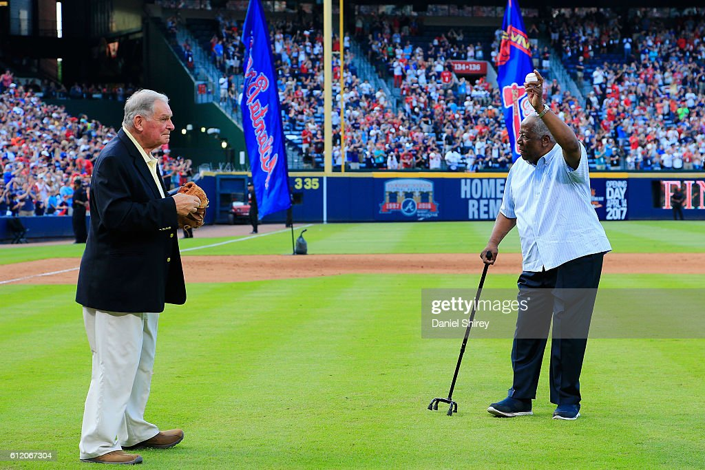 Hall of Famer Hank Aaron throws out the ceremonial last pitch at Turner Field to Bobby Cox after the game between the Atlanta Braves and the Detroit Tigers at Turner Field on October 2, 2016 in Atlanta, Georgia.