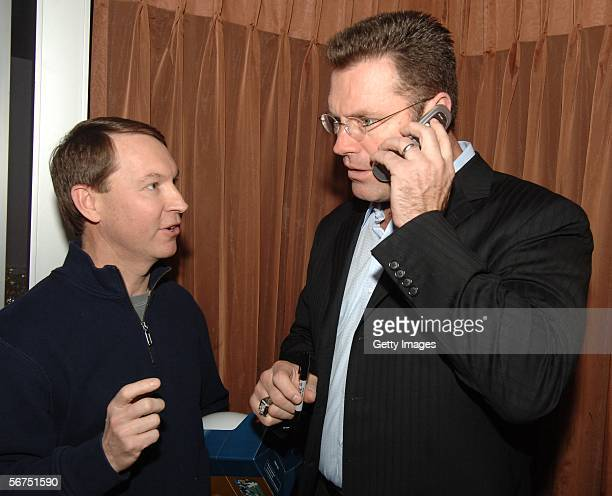 Hall of Famer Howie Long with Rudy Wedenoja and talking to Wedenoja's father on the phome during a Super Bowl XL BMC software Brunch at Andiamos...