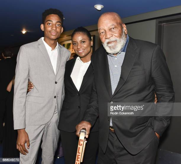 """Hall of Famer Jim Brown , son Aris Brown, and wife Monique Brown pose for portrait at premiere """"Spirit Game: Pride Of A Nation"""" on May 24, 2017 in..."""