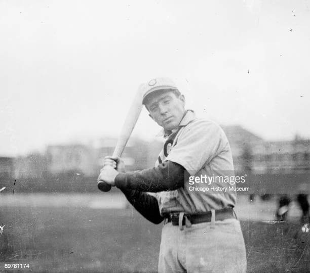 Hall of Famer Joe Tinker shortstop for the National League's Chicago Cubs facing camera holding a bat at West Side Grounds located between West Polk...