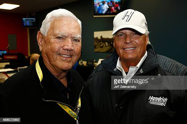 Hall of Famer Junior Johnson poses with team owner Rick Hendrick prior to the NASCAR Sprint Cup Series STP 500 at Martinsville Speedway on March 29...