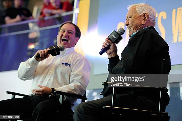 Hall of Famer Junior Johnson shares stories with the fans as Alex Hayden looks on during the NASCAR Fan Appreciation Day at the NASCAR Hall of Fame...