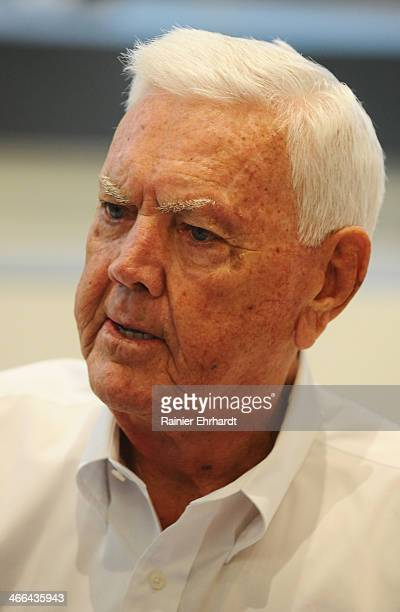 Hall of Famer Junior Johnson signs autographs for fans during the NASCAR Fan Appreciation Day at the NASCAR Hall of Fame on February 1 2014 in...