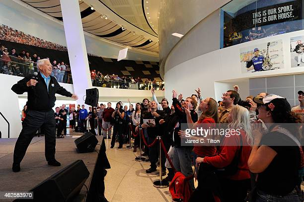 Hall of Famer Junior Johnson tosses memorabilia to the fans during the NASCAR Fan Appreciation Day at the NASCAR Hall of Fame on January 31 2015 in...