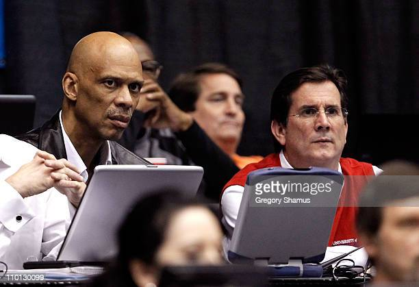 Hall of Famer Kareem AbdulJabbar and University of Dayton President Daniel J Curran look on during the game between the Arkansas Little Rock Trojans...