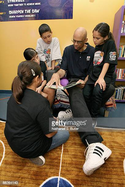 Hall of Famer Kareem AbdulJabbar reads to the children of the Boys Girls Club of Los Angeles during the unveiling of the Reading and Learning Center...