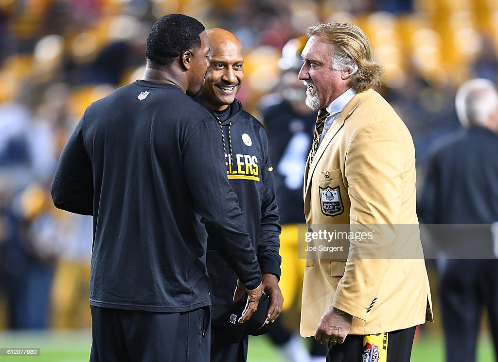 Hall of Famer Kevin Greene chats with Pittsburgh Steeler coaches Carnell Lake and Joey Porter during warmups before the game against the Kansas City Chiefs at Heinz Field on October 2, 2016 in Pittsburgh, Pennsylvania.