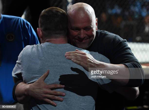 UFC Hall of Famer Matt Hughes hugs UFC President Dana White during the UFC Fight Night event inside the Scottrade Center on January 14 2018 in St...