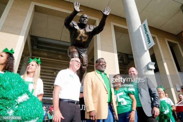Hall of Famer Mean Joe Green is presented a statue by North Texas President Neal Smatresk and North Texas Athletic Director Wren Baker before the...