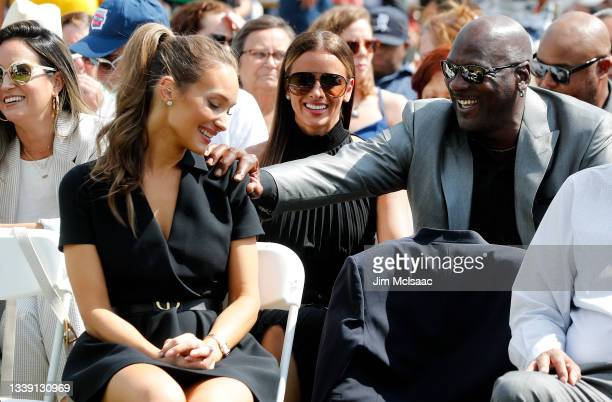 Hall of Famer Michael Jordan has a laugh with Hannah Jeter, wife of inductee Derek Jeter, during the Baseball Hall of Fame induction ceremony at...