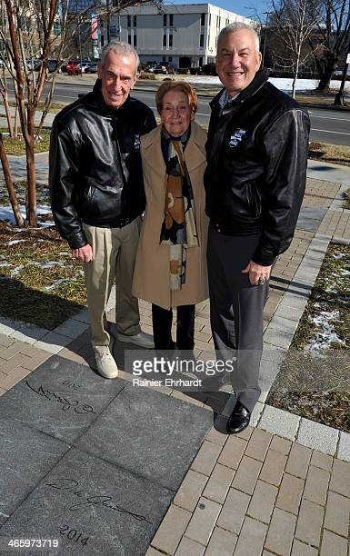 Hall of Famer Ned Jarrett his wife Martha Jarrett and 2014 inductee Dale Jarrett pose with a granite marker bearing his name during the NASCAR Hall...