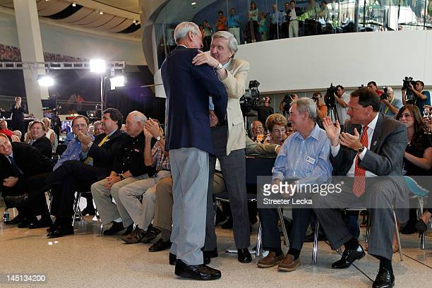 Hall of famer Ned Jarrett hugs Ken Squier during Voting Day at the NASCAR Hall of Fame on May 23 2012 in Charlotte North Carolina