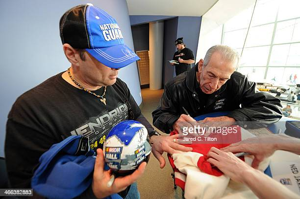 Hall of Famer Ned Jarrett signs autographs for fans during NASCAR Hall of Fame Fan Appreciation Day at NASCAR Hall of Fame on February 1 2014 in...