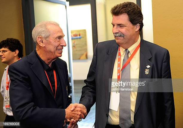 NASCAR Hall of Famer Ned Jarrett talks with NASCAR President Mike Helton during the Hall of Fame Selection at NASCAR Hall of Fame on May 22 2013 in...