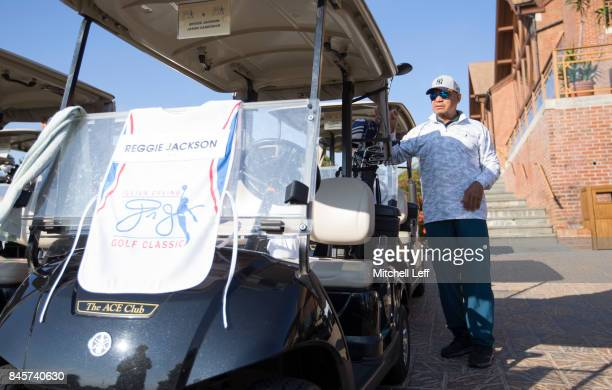 Hall of Famer Reggie Jackson grabs his clubs during the Julius Erving Golf Classic at The ACE Club on September 11 2017 in Lafayette Hill Pennsylvania