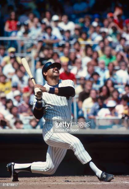Hall of Famer Reggie Jackson of the New York Yankees watches the ball he batted fly during at Yankee Stadium in Bronx New York