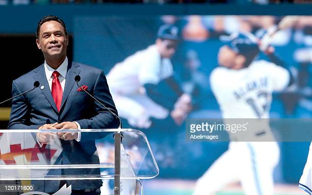 Hall of Famer Roberto Alomar speaks during a ceremony to retire his jersey at the Rogers Centre July 31 2011 in Toronto Ontario Canada