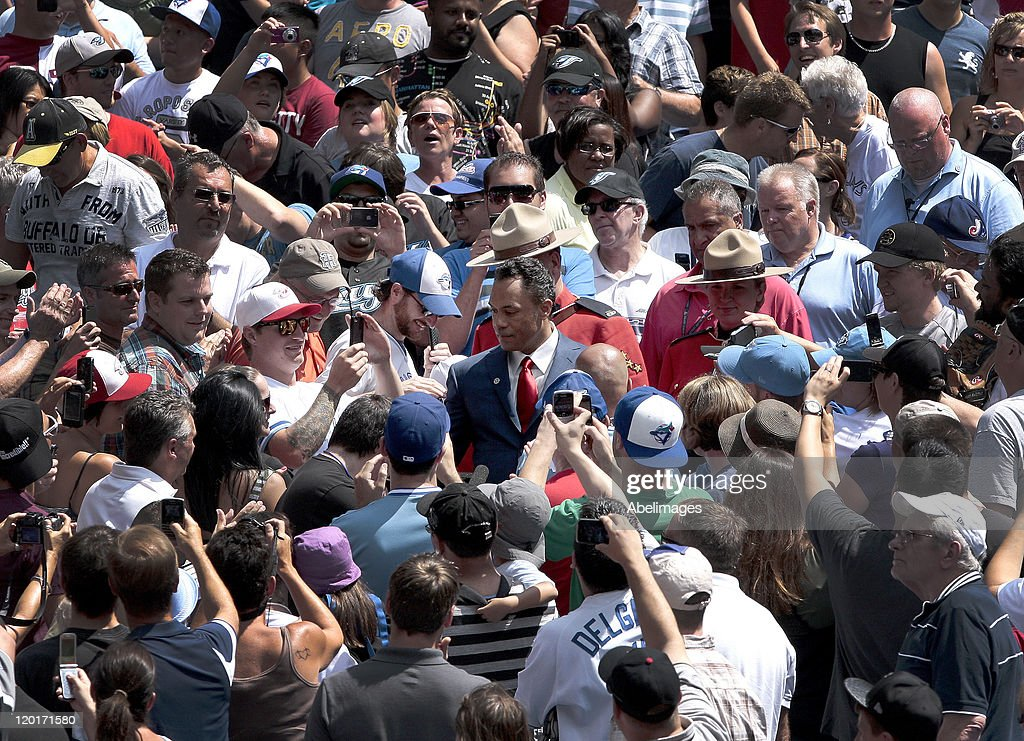 Hall of Famer Roberto Alomar walks through the fans on his way to the field for a ceremony to retire his #12 jersey at the Rogers Centre July 31, 2011 in Toronto, Ontario, Canada.
