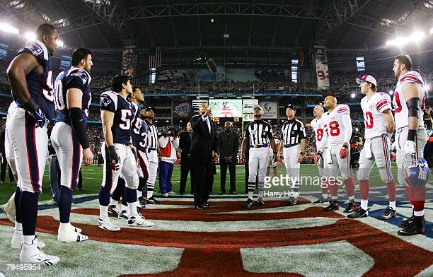 Hall of Famer Ronnie Lott performs the coin toss before the New York Giants take on the New England Patriots during Super Bowl XLII on February 3...