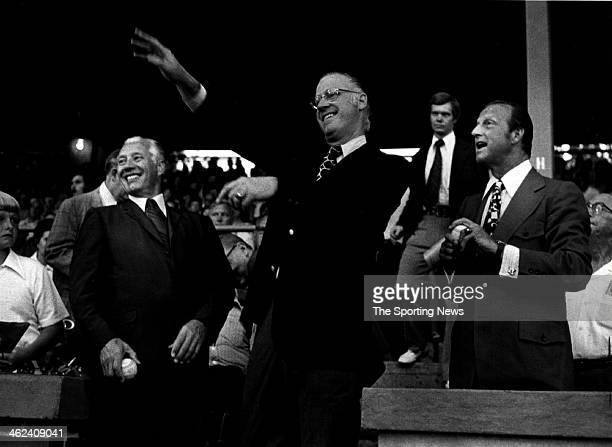 Hall of Famers Bob Feller and Stan Musial flank Major Leabue Baseball Commissioner Bowie Kuhn as Kuhn tosses out the first pitch prior to the...