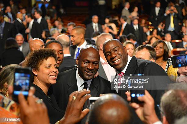 Hall of Famers Cheryl Miller Michael Jordan and Magic Johnson smiles for a photo prior to the 2012 Basketball Hall of Fame Enshrinement Ceremony on...