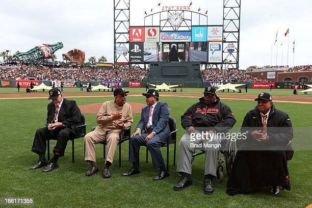 Hall of Famers Gaylord Perry Orlando Cepeda Juan Marichal Willie McCovey and Willie Mays sit on the field during the pregame ceremony honoring the...