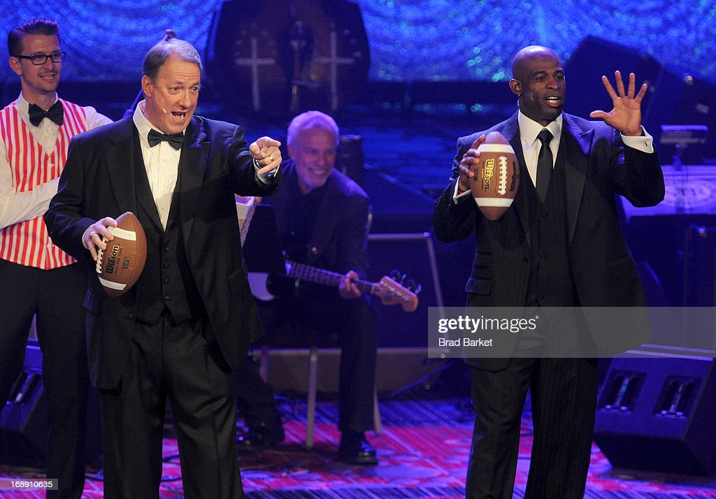 NFL Hall of Famers Jim Kelly (L) and Deion Sanders entertain attendees at the 2013 Toys'R'Us Children''s Fund Gala on Thursday, May 16 in New York City. One of the largest, single-night fundraisers in New York City, the Toys'R'Us Children's Fund Gala has raised more than $100 million, since its inception, to support charitable organizations that keep children safe and help them in times of need.