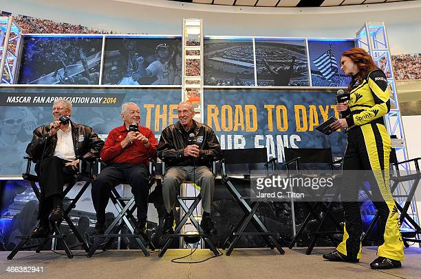 NASCAR Hall of Famers Leonard Wood Bobby Allison and Ned Jarrett speak with Miss Sprint Cup Madison Martin on stage during NASCAR Hall of Fame Fan...