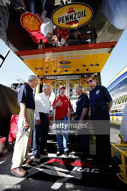 Hall of Famers Ned Jarrett Bobby Allison Kurt Busch driver of the Shell/Pennzoil Dodge David Pearson and Bud Moore talk in the garage area prior to...