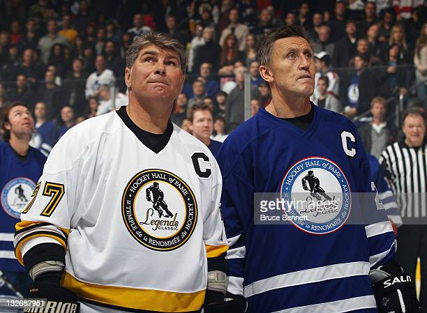 Hall of Famers Ray Bourque and Borje Salming stand at attention during the national anthem prior to the Legends Classic Game at the Air Canada Centre...
