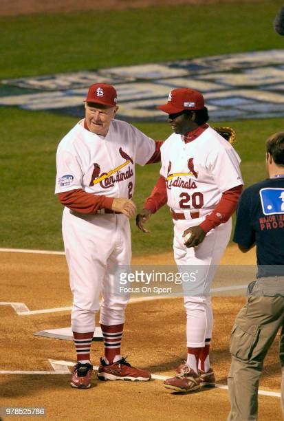 Hall of Famers Red Schoendienst and Lou Brock of the St Louis Cardinals participates in the first pitch ceremonies prior to GM 4 of the 2004 World...