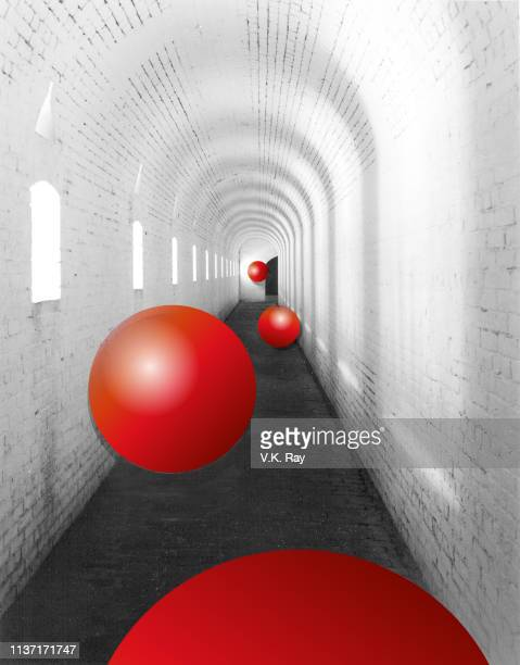 hall of red balls - bouncing ball stock photos and pictures