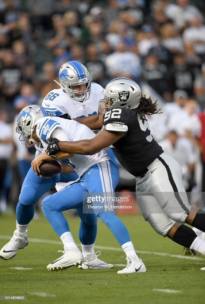 P.J. Hall #92 of the Oakland Raiders sacks quarterback Matt Cassel #8 of the Detroit Lions during the first quarter of their NFL preseason football game at Oakland Alameda Coliseum on August 10, 2018 in Oakland, California.