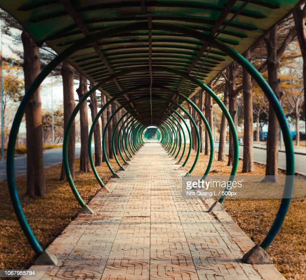hall with metal circles - symmetry stock pictures, royalty-free photos & images