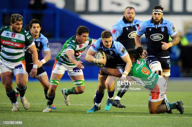 Hallam Amos of Cardiff Blues is tackled by Charly Trussardi of Benetton Treviso during the Guinness Pro14 Round 12 match between the Cardiff Blues...