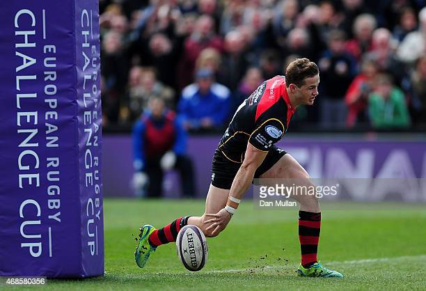 Hallam Amos of Newport Gwent Dragons scores his side's first try during the European Rugby Challenge Cup match between Newport Gwent Dragons and...