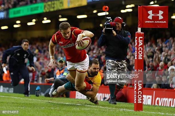 Hallam Amos of Wales is tackled into touch by Nick Frisby of Australia just short of the tryline during the international match between Wales and...